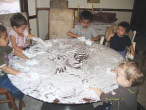 All Five Kids Cleaning the Table